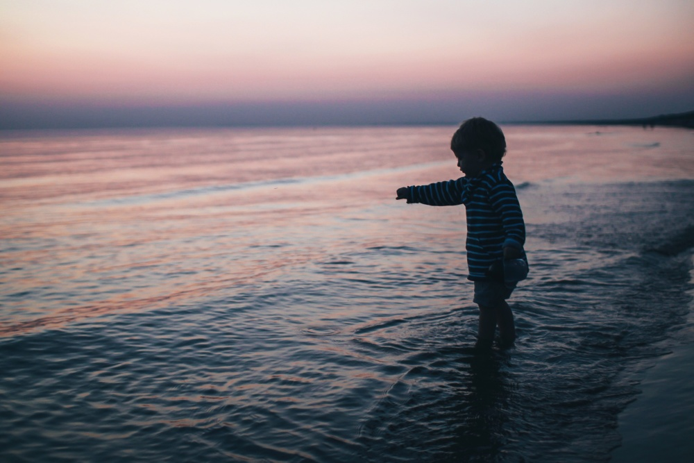 child, boy, beach, sea, dusk, Daiga Ellaby